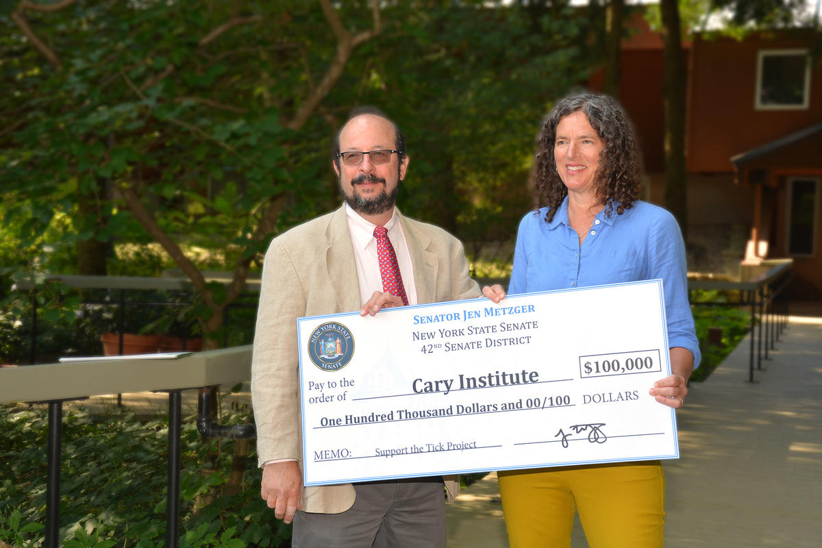 Metzger presents check for The Tick Project